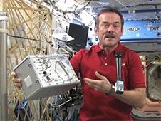 Commander Chris Hadfield shows off<br /> hardware and talks to media at the<br /> Canadian Space Agency.<br /> Credit: NASA TV