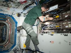 Flight Engineer Tom Marshburn works to<br /> install the redundant Ku Communications<br /> 1 unit in Destiny to complete the<br /> refurbishment of the Ku system aboard<br /> the International Space Station.<br /> Credit: NASA<br /> <br />